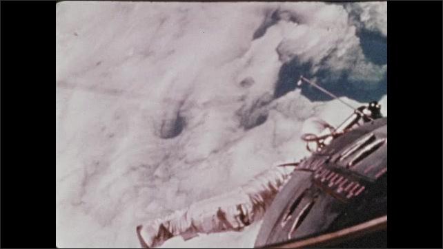1960s: Astronaut floats outside space shuttle.