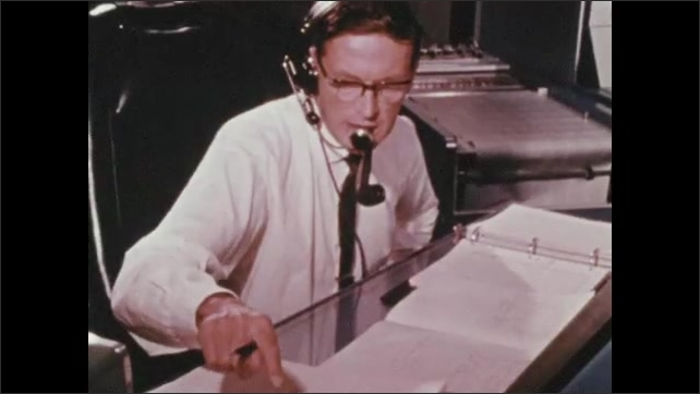 1960s: Control panels in cockpit of spacecraft. Large radar dish. Men in mission control room. Man at console. Men working equipment in mission control.