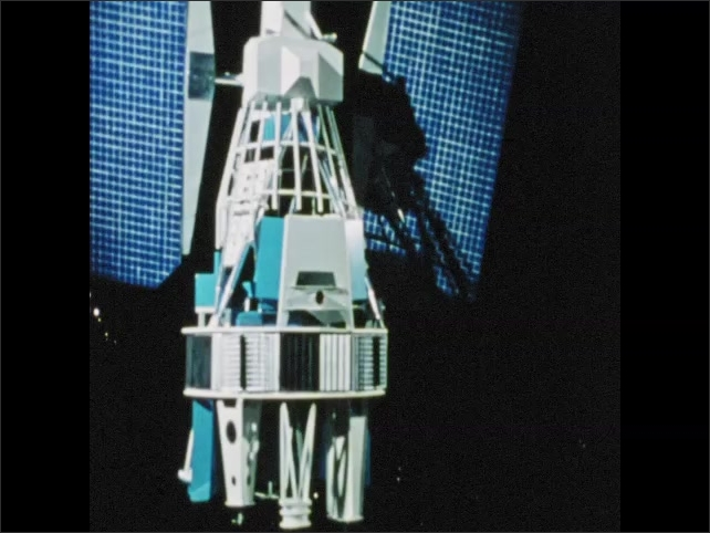 1970s: satellite's view of Earth from space, scientist in lab looking at images from satellite