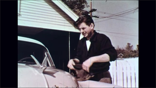 UNITED STATES 1950s : Dad Cleans the Car and Dog Wants to Play