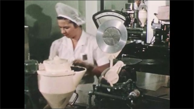 1950s: Woman works in factory.