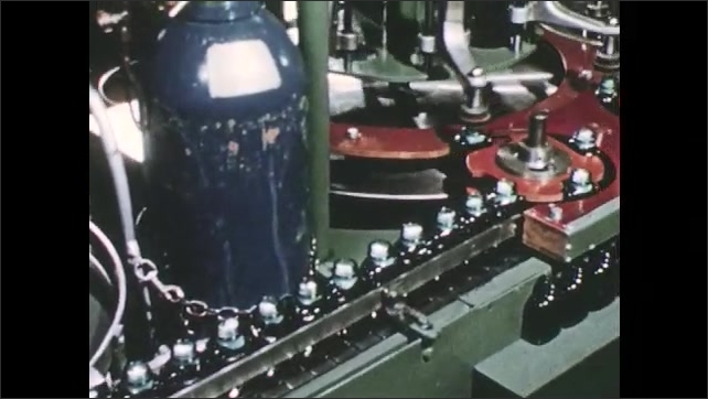 1950s: Machine stuffs cotton into pill bottles and puts on lids.  Conveyor belt moves bottles through assembly line.