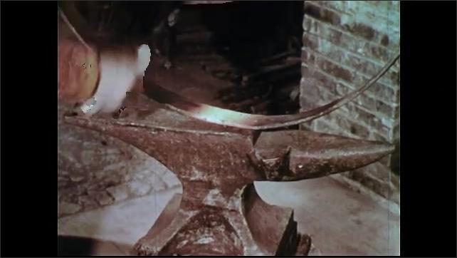 1950s: Men with horses. Man picks up horse's leg. Man puts metal wheel on anvil. Men watch man hammer. Hammer hits wheel. Men watch man hammer. Man hammering in workshop. Men talk on steps.
