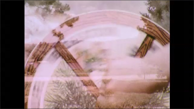 1970s: Chipmunk eats in the grass. Wheel turns to Water segment. Lake surrounded by forest. Wheel turns to Recreation section. Treetops and blue skies.