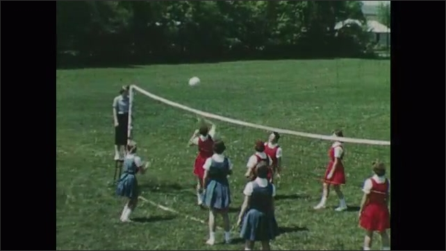 1950s: Girls play volleyball. Pointer points to players on diagram of volleyball team.