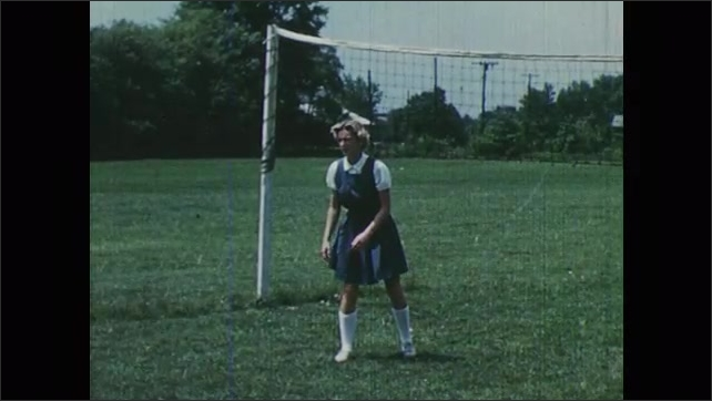 1950s: Girl practices hitting volleyball. Girls bounce volleyball between them.