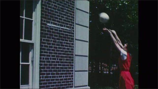 1950s: Girl practices hitting volleyball. Girl bounces ball against brick wall. Girl serves volleyball.