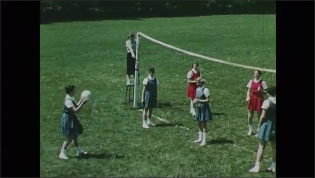 1950s: Girls play volleyball. Girls move in formation.