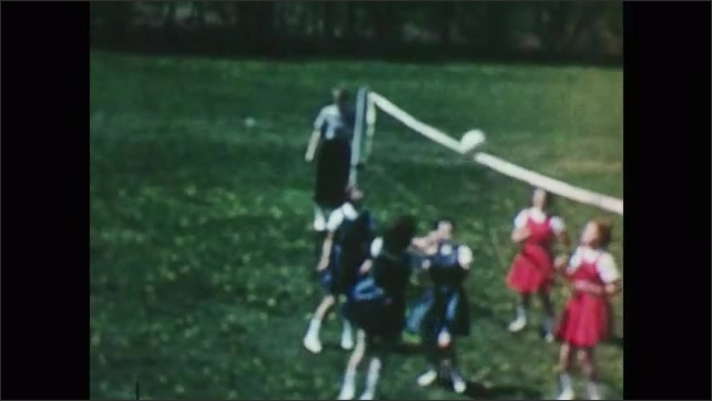 1950s: Girls play volleyball.