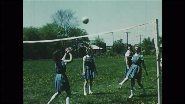 1950s: Girls practice volleyball.
