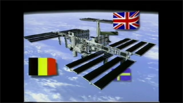 1990s: Animation, space station being assembled. Tracking shot to man at computer. Man and woman in spacecraft. Animation, flags appear around space station.