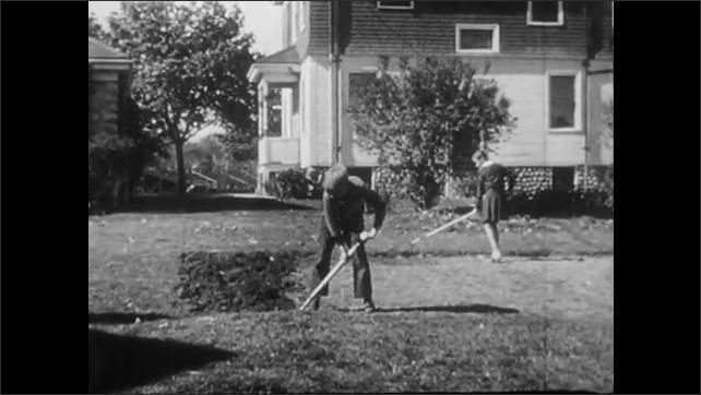1940s: UNITED STATES: foot presses spade into soil. Boy loosens soil in garden. Children prepare ground for vegetable patch. Children arrive at gardening supply store. Children buy seeds