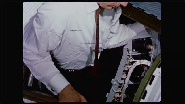 1960s: Gus Grissom in flight capsule. Scott Carpenter climbs into flight capsule.