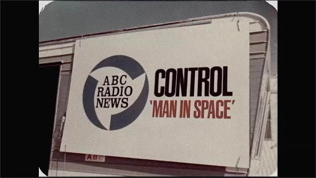 1960s: UNITED STATES: ABC Radio News truck. Control 'Man in Space' title. The Voice of America banner.
