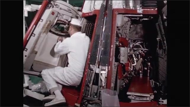 1960s: UNITED STATES: capsule in workshop. Post flight testing of capsule.