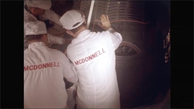 1960s: Technicians seal astronauts into rocket.