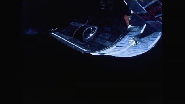 1960s: Spacecraft.  Astronaut at window.