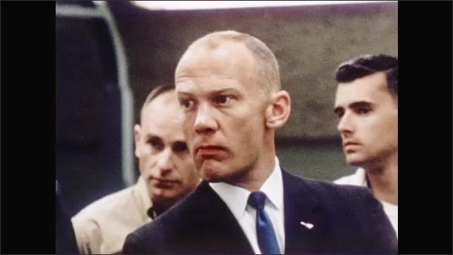 1960s: UNITED STATES: Astronauts enjoy tour of facility. Man listens to speaker.