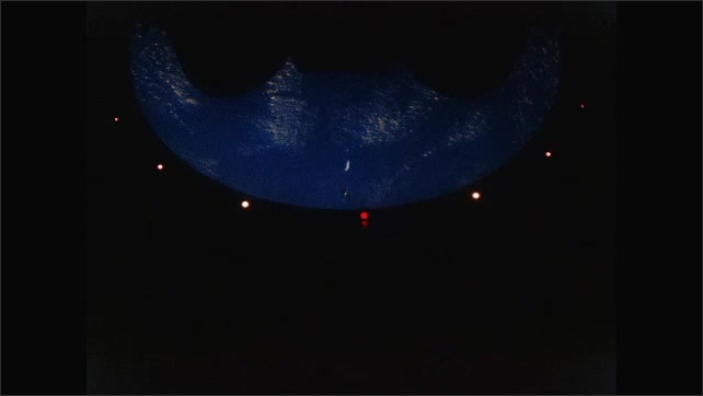 1960s: UNITED STATES: modules split in space. Module falls away. Lights around ring. View of planet below.