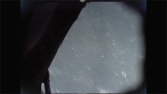 1960s: Looking at surface of moon from spacecraft.