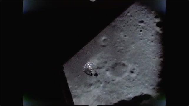 1960s: Watching lunar module descend to surface of moon from spacecraft.
