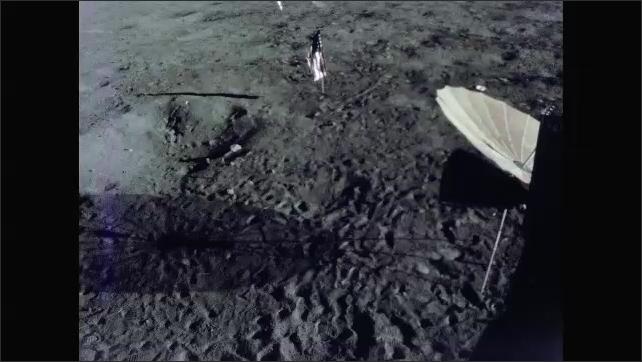 1960s: Astronaut walks on surface of moon.