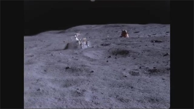 1960s: Astronaut drives vehicle across surface of moon.
