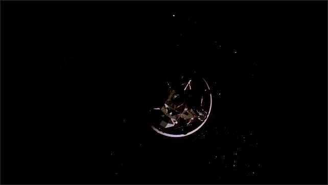 1960s: Earth.  Spacecraft in orbit.  Men in cabin.