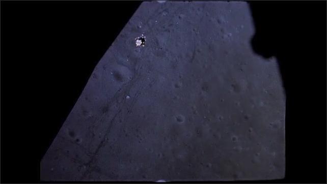 1960s: Spacecraft flies over surface of moon.