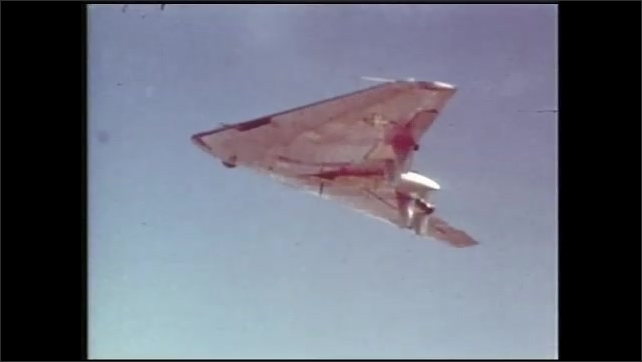 1990s: Blended wing aircraft flies through sky. Woman speaks to teen boy and girl in lab.