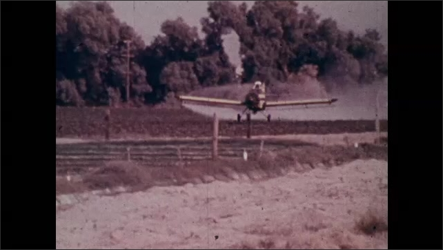 1970s: Pan across field of crops, smoke in background. Plane dusts crops. Long shot, men next to tanks, man opens valve. Zoom in, men exit van next to river.