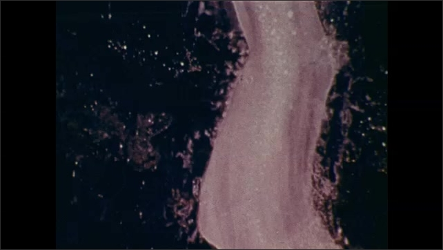 1970s: Close up of fumarole. Close up of steam rising in soil, split screen of steam and fumarole.