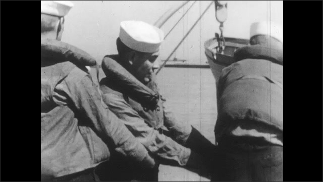 1950s: UNITED STATES: sailors prepare boat. Sailors in life jackets. Sailors relax in mess.