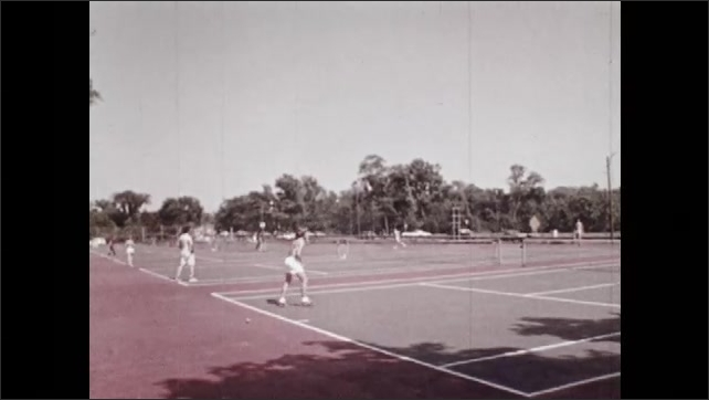 1970s: Volleyball game.  Baseball game.  Tennis courts.  People ride bikes.  Men golf.