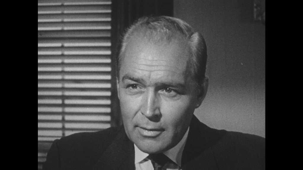 1950s: Office.  Men speak.