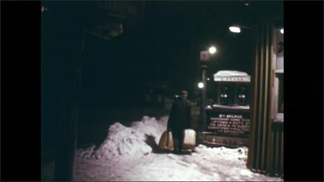 1970s: City street at night.  People on beach.  People walk down snowy street.  Man shovels snow.  Cloudy sky.  Lightning strike.