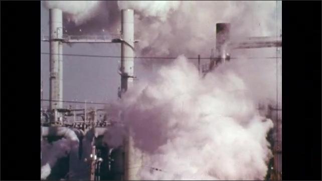 1970s: Lightning strike.  Factory.  Smoke pours from smokestacks.