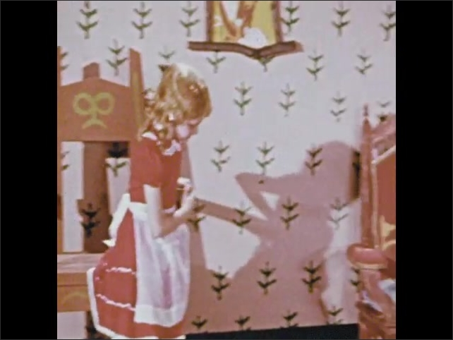 1950s: Girl in pink dress stands inside fairytale house, looking at three different sized chairs. Girl climbs in large chair. Girls sits in medium sized chair. Girl sits in baby sized chair.