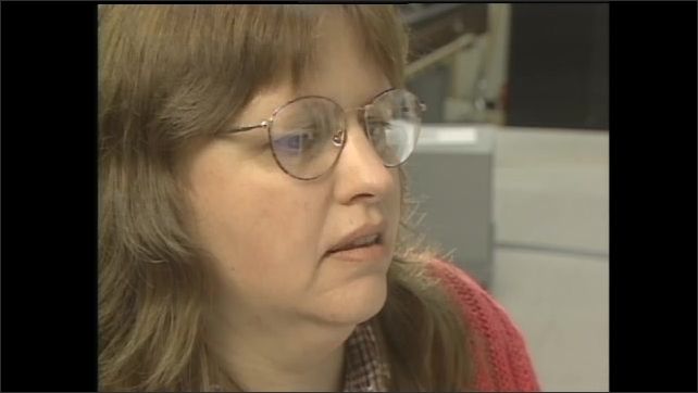 1990s: Lobby, display on Atmospheric Sciences, earth, remote sensing, woman walks in. Office, woman works at computer, uses mouse, looks at graph on screen. NASA Langley, vacuum spheres.