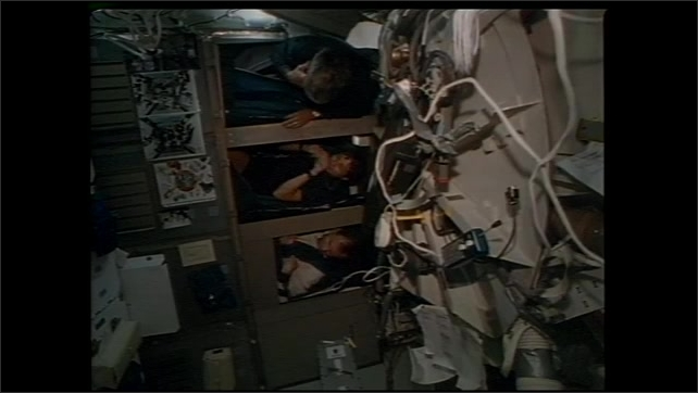 1990s: UNITED STATES: astronauts walk to shuttle. Astronauts during space flight. Astronaut on exercise machine in space. Personal and social needs of crews in space.