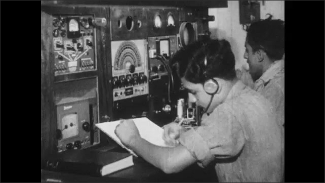 1960s: Boy working with equipment. Boys with headphones at control panel.