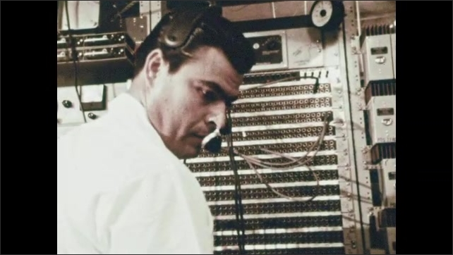 1960s: MEXICO: Man works at computer. Man works at switchboard.