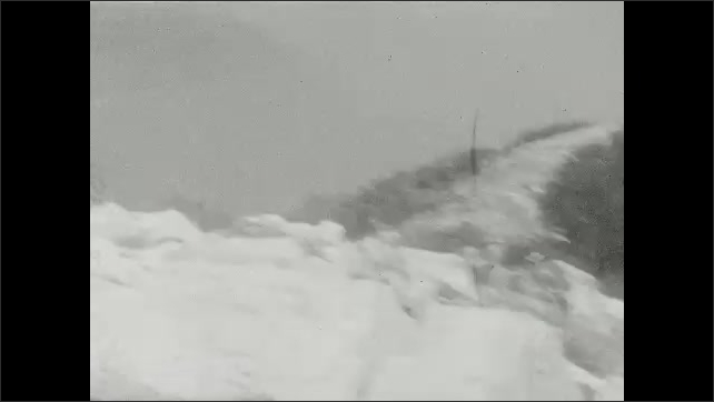1920s: Man and girl run down path. Girl and boy stand by viewfinders, boy looks through viewfinder. Tree. People stand on mountaintop.