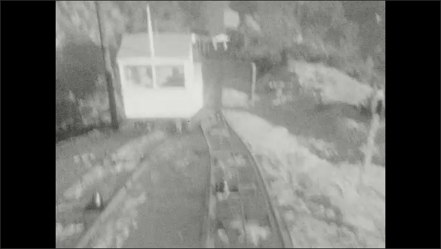 1920s: Mountains. Cable car travels up mountain. Tracks. End of the line.