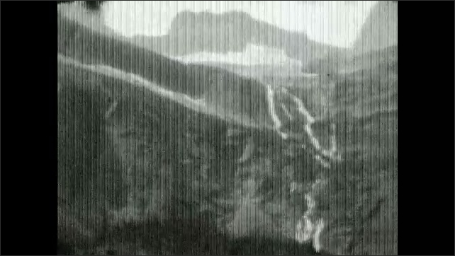"""1930s: Sign reads """"FOOT TRAVEL ONLY.  GRINNELL LAKE.""""  People stand."""