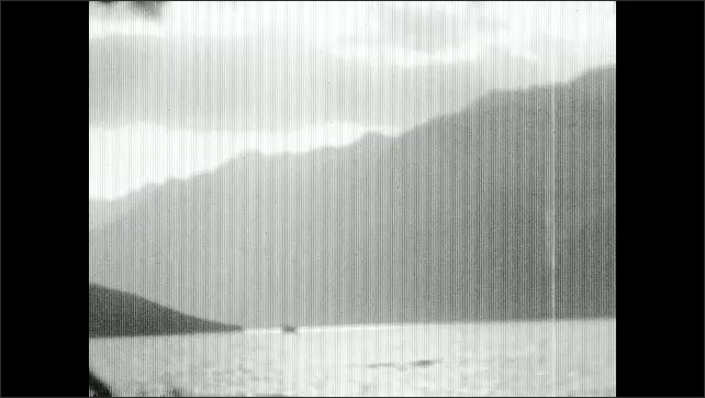 1930s: Sky.  Lake.  Mountains.  Hotel.
