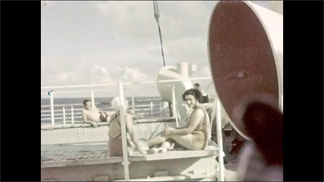 1930s: Woman leans on a pole by a pool. Two women sit on the edge of a pool on a cruise ship, they stand up and walk around to the other side of the pool and return.