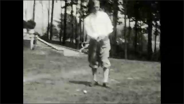 1930s: Men shake hands on golf course. Men drive golf balls from green.