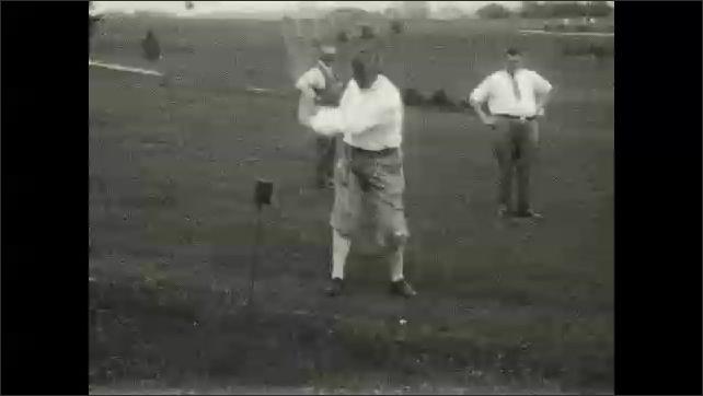 1930s: Men drive golf balls from green. Men walk along golf course. Men drive golf balls along fairway. Men putt golf ball along green.