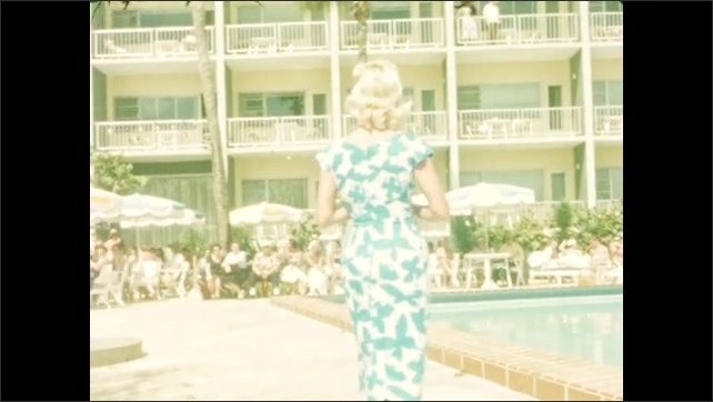 1940s: Woman models in yellow dress with pink coat by poolside of hotel. She takes off coat. Woman models in blue and white dress. Woman models in salmon colored dress.